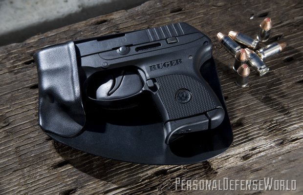 """The innovative design of Recluse holsters eliminates any """"printing."""" The handgun is holstered by placing the muzzle into the pouch and then bringing it into place from the side"""