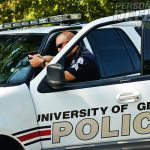 traffic stops. This U of GA officer stands ready with his GLOCK behind vehicle cover.