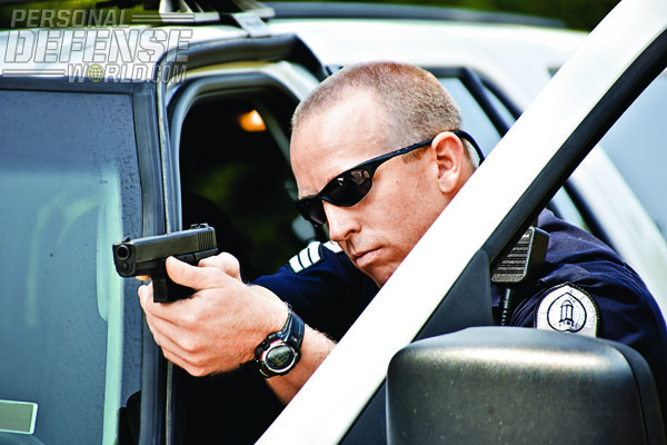 The use of excellent tactics are a must when using an outstanding duty pistol such as the GLOCK—here, this officer has made full use of cover behind his vehicle during a felony takedown.