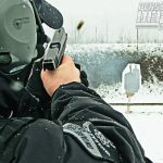 Threats do not always present themselves in convenient locations with good weather. Here, an officer trains with his Glock 22 pistol in a winter training environment.