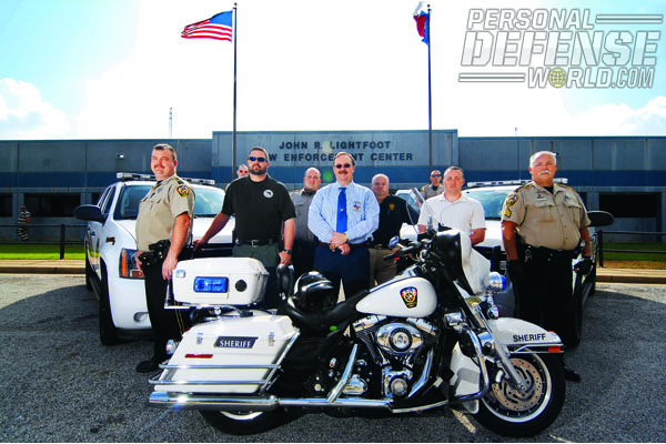 Following his election in 2001, Nacogdoches Sheriff, Thomas Kerss, center, initiated a program to select the best patrol sidearm for his deputies. After extensive evaluation, the Sheriff's Office selected the GLOCK 31.