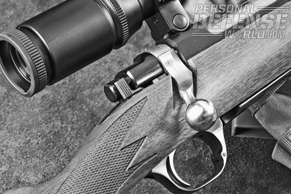 The short .308 retains the standard 3-position winged safety of the current M77 line.