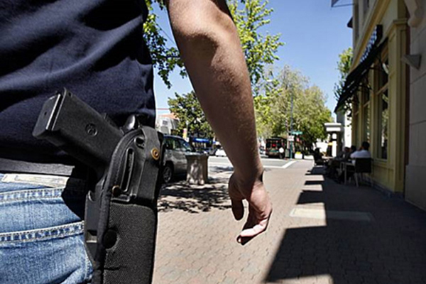 Kansas legislators are considering a new gun rights proposal which would prohibit cities and counties from banning the open-carry of guns.