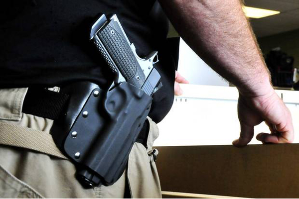 The town of Castle Rock, Colo. has officially voted to a repeal a ban which prevented open-carry of a firearm in public buildings and parks.