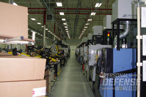 """The plant employs a """"super cell"""" approach to manufacturing in which employees and machines are organized and grouped together the maximize efficiency and minimize waste."""