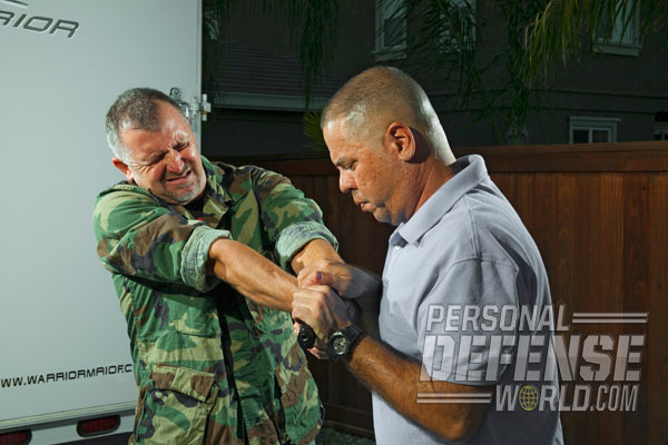 Grip the gun (and ideally the attacker's wrist) with overhand grips and pull the gun to your chest.