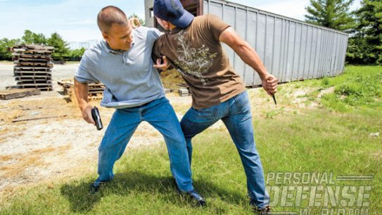 An overarm grip just above the attacker's elbow limits his mobility and keeps you well away from a deadly knife thrust.