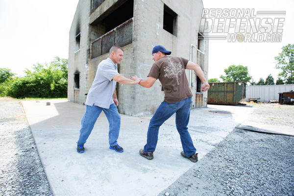 If your attacker is taller, or reaches toward your face with his left hand, reaching over his arm to control it may not be practical.