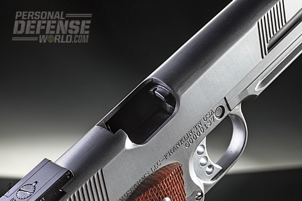 The ejection port is lowered and flared for enhanced reliability.