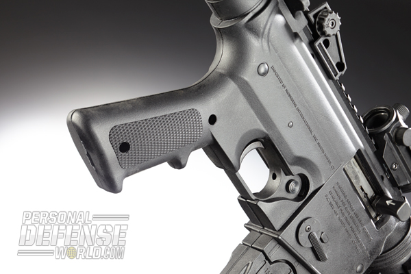 AR-15 users will feel at home with the 715P's standard A2-style grip.