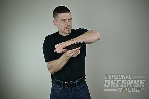 (4) Using an overhand grip, rip-rack the slide like you are trying to rip it off of the frame