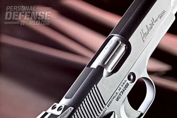 The pistol's barrel hood features longitudinal grooves on its exterior.