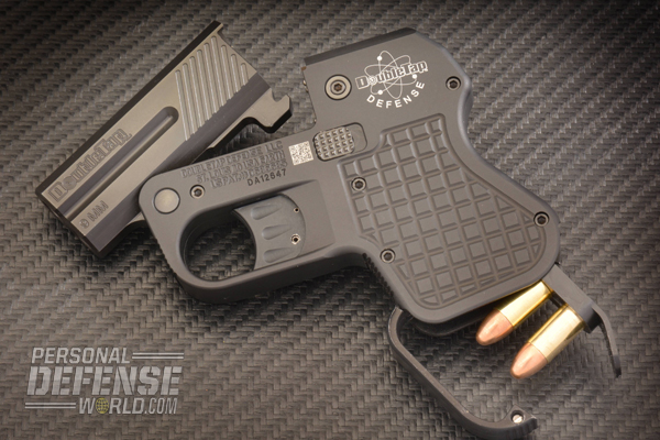 The hinged cover at the base of the grips conceals a storage compartment that can hold two extra rounds on a DoubleTap speed strip.