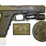 The Kentucky Special Response Team's issue GLOCK 35 (note the slide marking) and agency uniform patches.