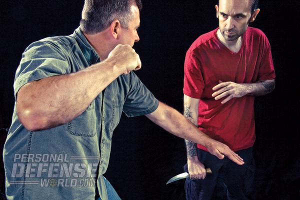 Once you pin and secure the weapon hand of your attacker, follow up with an onslaught of strikes to take him down hard!