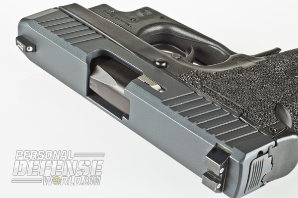 Sniper Gray Cerakote and black Salt Bath Nitride finish the slide and barrel on the CM9.