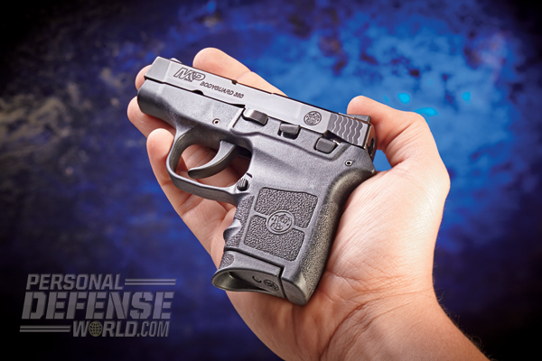 Controls are standard on this palm-sized protector: Above the trigger is the takedown lever, behind that is the slide lock lever, and to the rear of that is the safety lever. Note the serrated mag release.