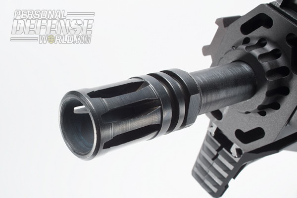 Capping the gun's 11-inch barrel is an A2-style flash suppressor.