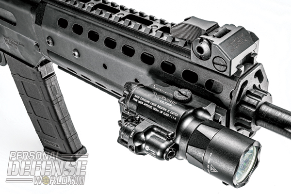 Accessory rail located on the right side of the handguard allows for the attachment of tactical lasers and lights, like the SureFire X-400 Ultra (shown).