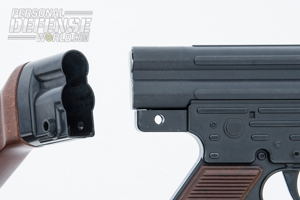 The upper receiver separates from the buttstock group, allowing the bolt carrier to be removed for cleaning.