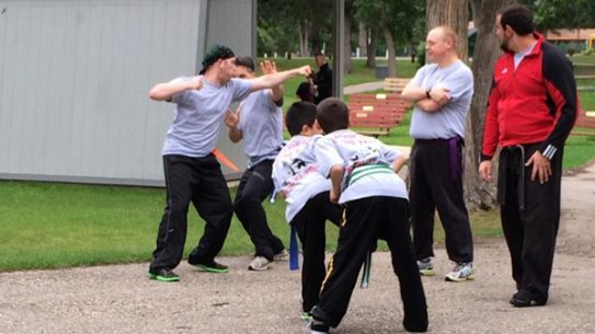 """Moore's Shou Shu Martial Arts hosted its annual """"Kickin' It in the Park"""" self-defense event in Minot, ND. (Photo: Facebook)"""