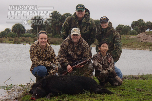 Front row (l-r), author Olivia Vigna with her second boar; John Vigna (father); Sophie Vigna (sister), who took her first boar on this particular trip; and the grandparents Al and Barbara in the back row.
