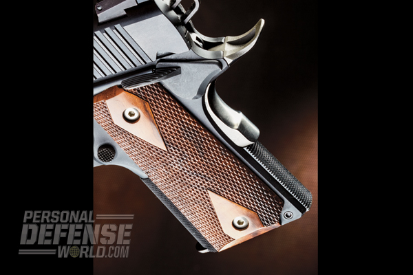 The 1911U features a high-sweep beavertail and checkered walnut grips.