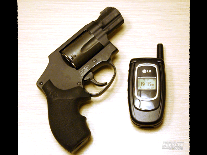 Even when you're inside your home, keep a gun, such as this S&W M&P340, and a cell phone on your person in case a home invader strikes.