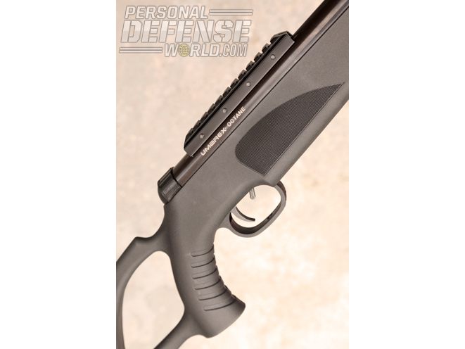 The durable synthetic stock features a thumbhole and a ribbed grip for better control. The safety is a small lever just ahead of the trigger.