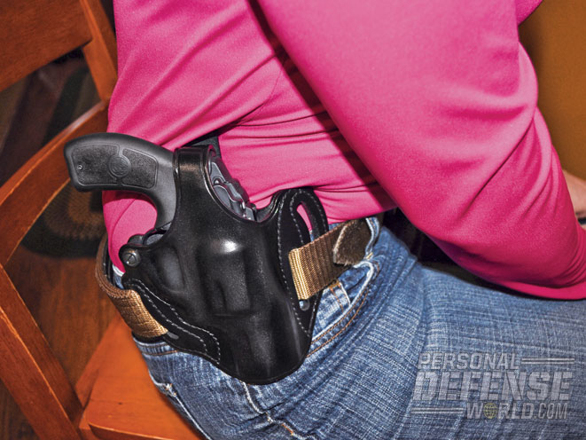 Worn strong side, the holster dug into the author's side.