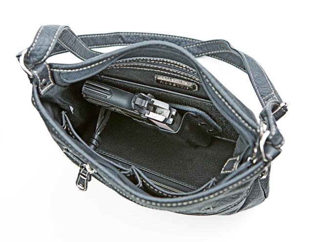 CrossBreed Holsters Purse Defender, crossbreed, crossbreed holsters, holsters, holster, concealed carry, concealed carry for women, women's concealed carry
