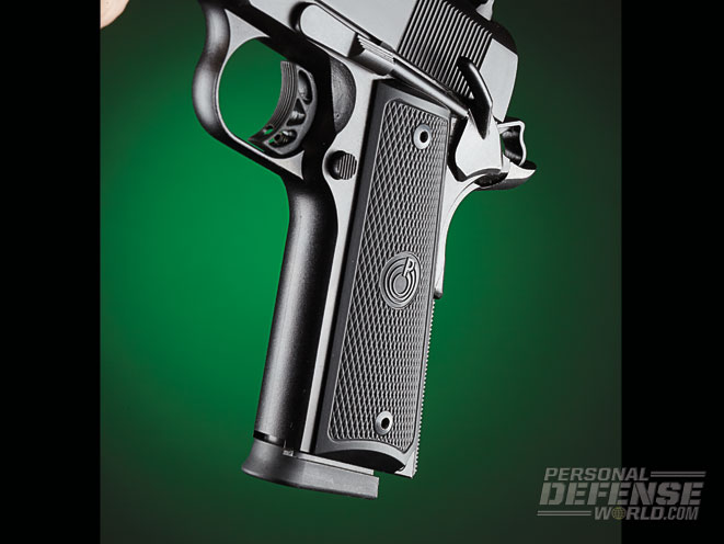The Expert 1911 features checkered polymer grip panels and a left-side-mounted safety.