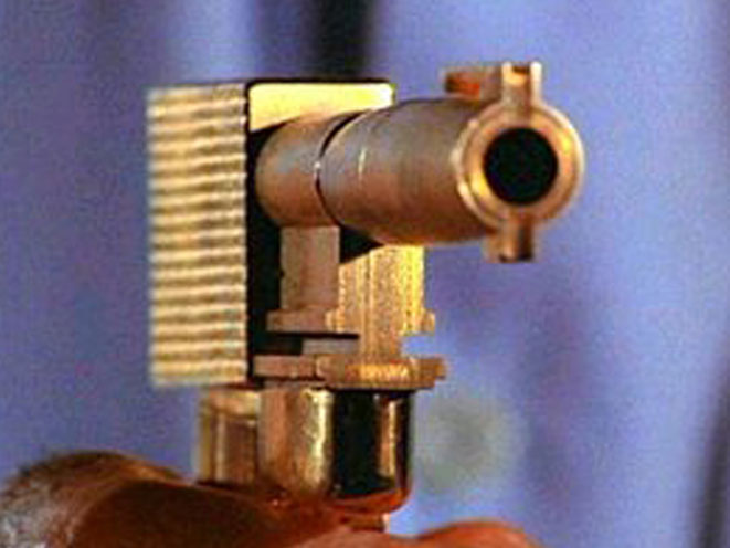 the man with the golden gun, golden gun, the golden gun, james bond golden gun, bond golden gun, golden gun photo