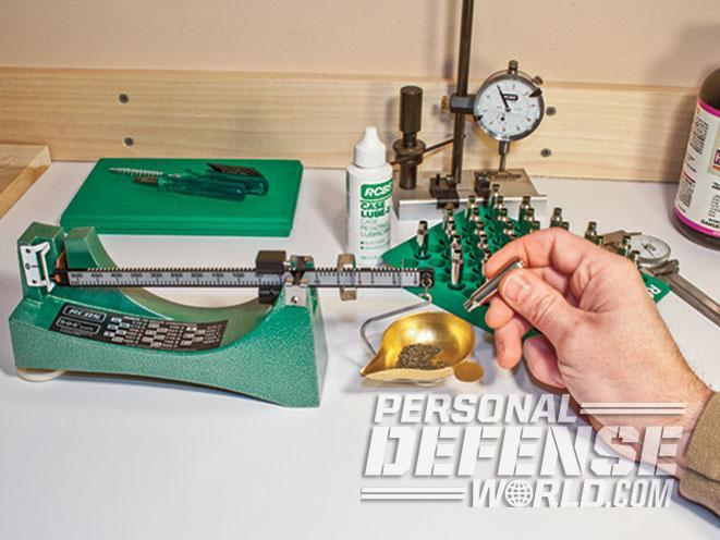 powder, gun powder, gunpowder, powder charge, powder charges, cartridge case, balance beam