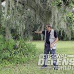 warning shots firing into bush