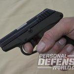 ortgies vest pocket and kel-tec p-32 pistol in hand