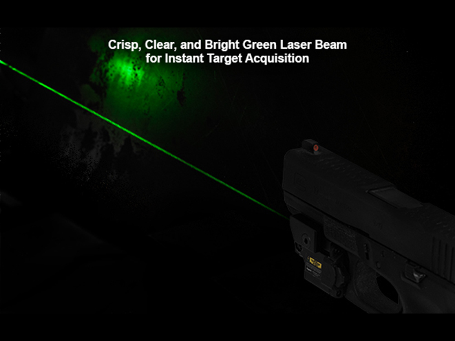 UTG Compact Ambidextrous Green Laser in darkness