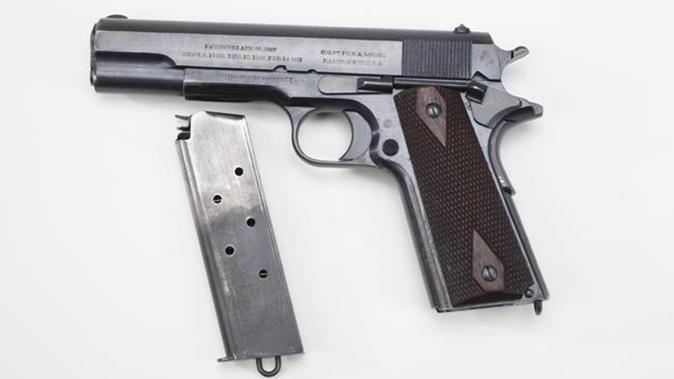 us army surplus m1911 pistol left profile with magazine