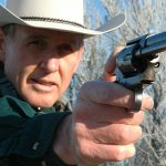 colt peacemaker revolver aiming