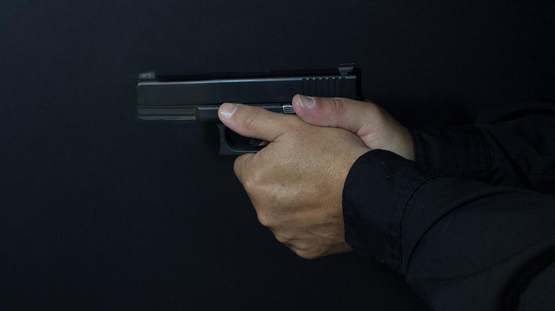 Pistol grip ways to hold a handgun thumbs forward