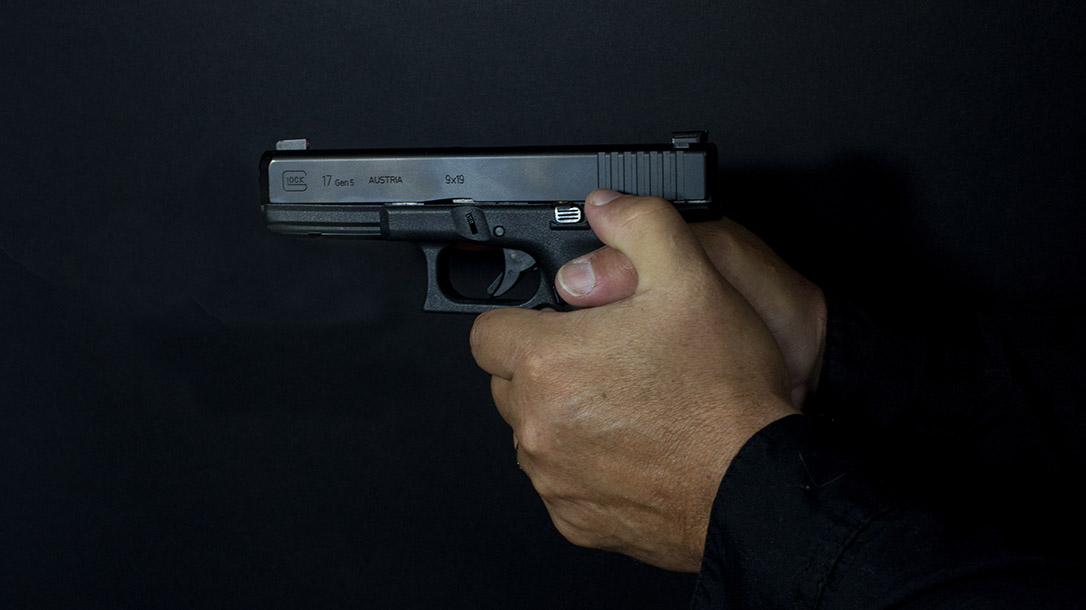 Pistol grip ways to hold a handgun interlocked thumbs