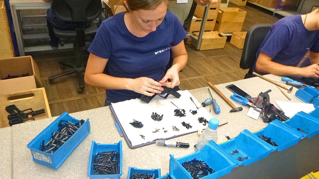 arex rex pistol female worker