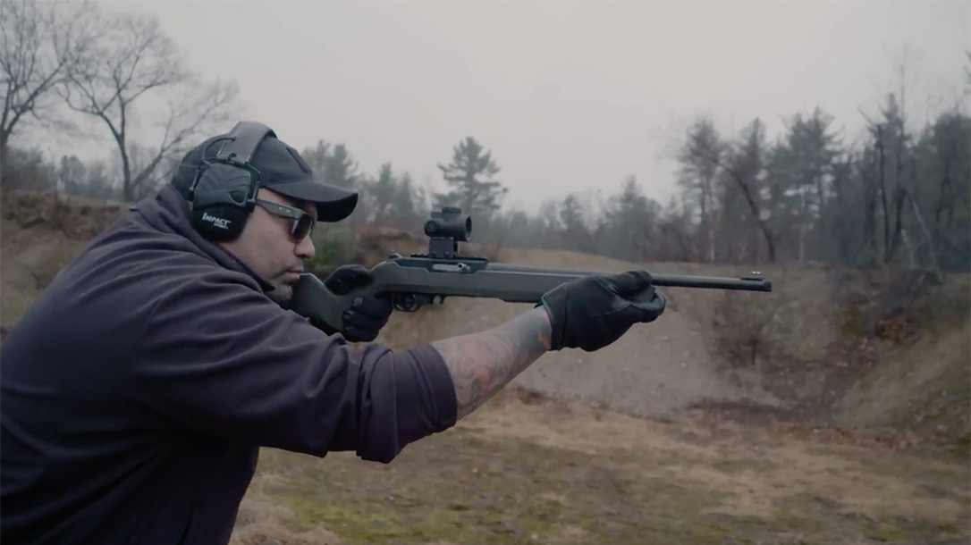 Thompson/Center Arms T/CR22 rifle shooting standing position