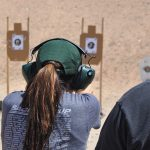 new female shooters shooting target