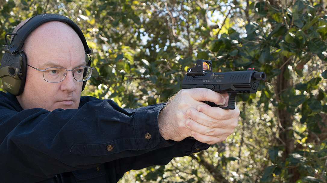 Walther PPQ Q4 TAC Pistol author shooting