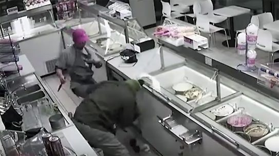 A Baskin-Robbins Employee fights off a robber armed with knife
