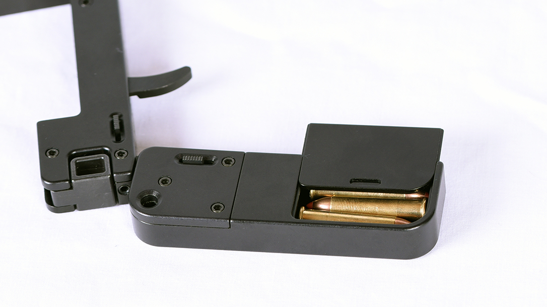 An ammo reservoir provides extra rounds for loading.