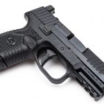 Textured grip panels provide a secure grip for shooters.