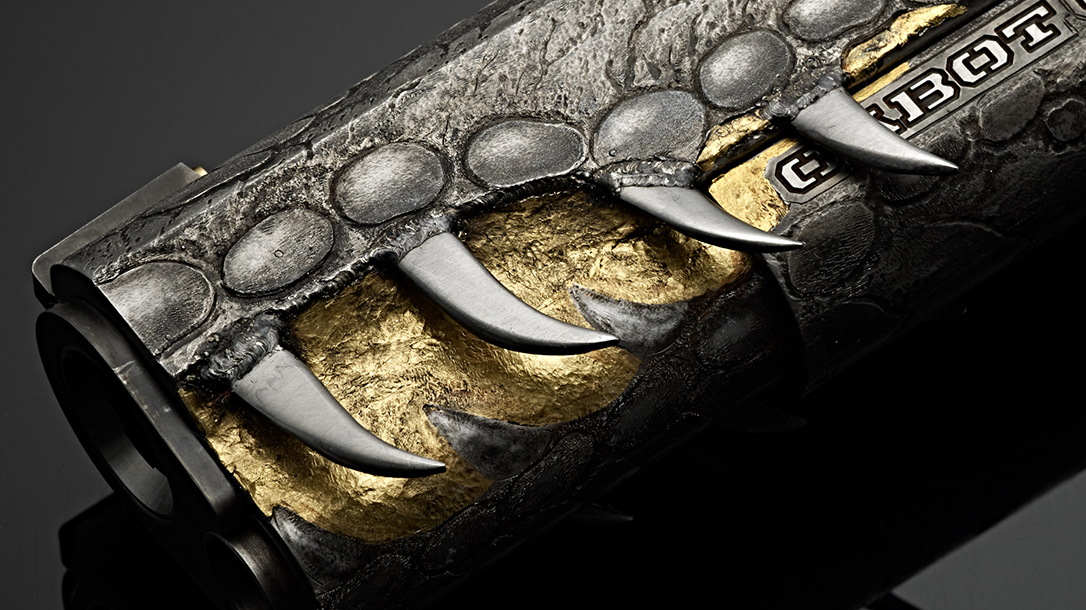 A master engraver cut, polished and welded teeth to the slide.
