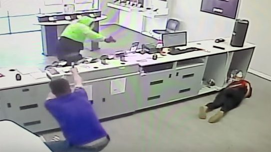 A MetroPCS worker fought back, ultimately shooting and wounding a masked, armed robber, saving himself and co-worker during crazy shootout in Virginia.